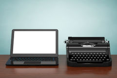 Modern Laptop Computer with Antique Typewriter. 3d Rendering stock illustration