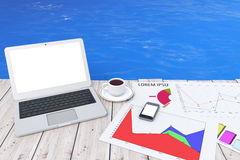 Modern Laptop with Cup of Coffee and Business Graph in front of Royalty Free Stock Photos