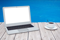 Modern Laptop with Cup of Coffee in front of Ocean. 3d Rendering Royalty Free Stock Photo