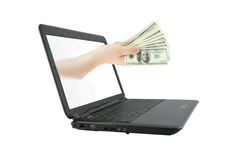 Modern laptop and hand with money isolated Royalty Free Stock Photos