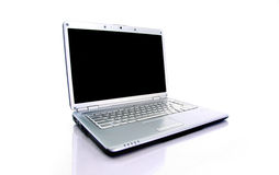 Modern laptop isolated. On white with reflections on glass table royalty free stock photo