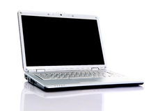 Modern laptop isolated on white. With reflections on glass table royalty free stock photography