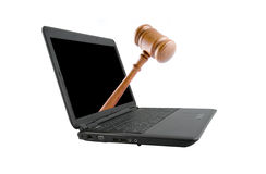 Modern laptop with judge's gavel isolated Stock Photos