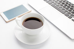 Modern laptop with mobile phone and cup of coffee Stock Photo
