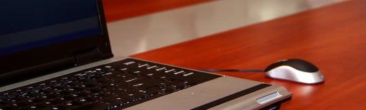Modern Laptop & mouse on a desk Stock Photos