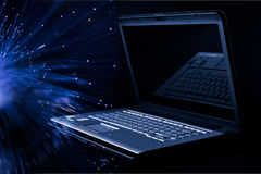 Modern laptop over black background Stock Photo