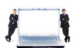 Modern laptop and two businessmans Stock Photography