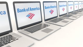 Modern laptops with Bank of America logo. Computer technology conceptual editorial 4K clip, seamless loop. Modern laptops with Bank of America logo. Computer stock video