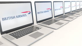 Modern laptops with British Airways logo. Computer technology conceptual editorial 3D rendering. Modern laptops with British Airways logo. Computer technology vector illustration