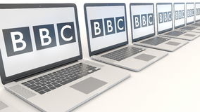 Modern laptops with British Broadcasting Corporation BBC logo. Computer technology conceptual editorial 3D rendering Stock Image