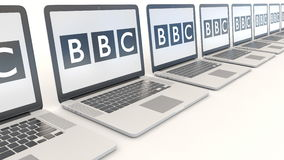 Modern laptops with British Broadcasting Corporation BBC logo. Computer technology conceptual editorial 4K clip. Modern laptops with British Broadcasting royalty free illustration