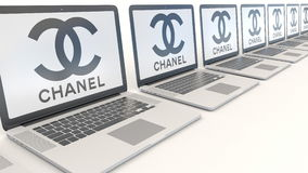 Modern laptops with Chanel logo. Computer technology conceptual editorial 3D rendering Royalty Free Stock Image