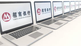 Modern laptops with China Merchants Bank logo. Computer technology conceptual editorial 3D rendering Royalty Free Stock Photography