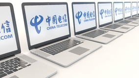 Modern laptops with China Telecom logo. Computer technology conceptual editorial 4K clip, seamless loop stock footage