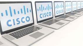 Modern laptops with Cisco Systems logo. Computer technology conceptual editorial 3D rendering Stock Photos