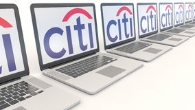 Modern laptops with Citigroup logo. Computer technology conceptual editorial 4K clip, seamless loop. Modern laptops with Citigroup logo. Computer technology stock footage