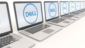 Modern laptops with Dell Inc. logo. Computer technology conceptual editorial 4K clip, seamless loop. Modern laptops with Dell Inc. logo. Computer technology stock footage