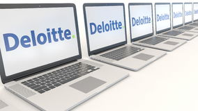 Modern laptops with Deloitte logo. Computer technology conceptual editorial 3D rendering. Modern laptops with Deloitte logo. Computer technology conceptual Royalty Free Stock Photography