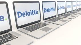 Modern laptops with Deloitte logo. Computer technology conceptual editorial 4K clip, seamless loop. Modern laptops with Deloitte logo. Computer technology stock video