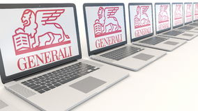 Modern laptops with Generali Group logo. Computer technology conceptual editorial 3D rendering Stock Photography