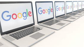Modern laptops with Google logo. Computer technology conceptual editorial 3D rendering Stock Image