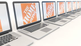 Modern laptops with The Home Depot logo. Computer technology conceptual editorial 4K clip, seamless loop. Modern laptops with The Home Depot logo. Computer stock video