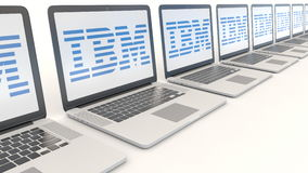 Modern laptops with IBM logo. Computer technology conceptual editorial 4K clip, seamless loop. Modern laptops with IBM logo. Computer technology conceptual stock video footage