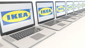 Modern laptops with Ikea logo. Computer technology conceptual editorial 3D rendering. Modern laptops with Ikea logo. Computer technology conceptual editorial 3D royalty free illustration