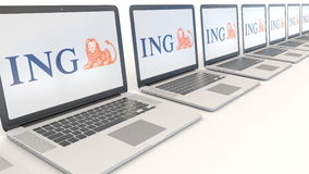 Modern laptops with ING Group logo. Computer technology conceptual editorial 3D rendering Stock Photo