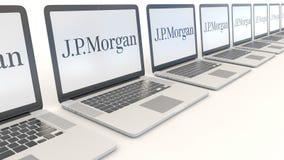 Modern laptops with J.P. Morgan logo. Computer technology conceptual editorial 4K clip, seamless loop. Modern laptops with J.P. Morgan logo. Computer technology stock video footage