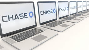 Modern laptops with JPMorgan Chase Bank logo. Computer technology conceptual editorial 3D rendering Stock Photo
