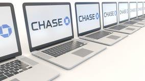Modern laptops with JPMorgan Chase Bank logo. Computer technology conceptual editorial 4K clip, seamless loop. Modern laptops with JPMorgan Chase Bank logo stock video