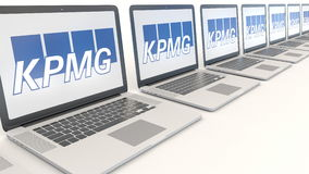 Modern laptops with KPMG logo. Computer technology conceptual editorial 3D rendering. Modern laptops with KPMG logo. Computer technology conceptual editorial 3D Royalty Free Stock Photos