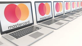 Modern laptops with MasterCard logo. Computer technology conceptual editorial 3D rendering Royalty Free Stock Photography