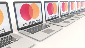 Modern laptops with MasterCard logo. Computer technology conceptual editorial 4K clip, seamless loop. Modern laptops with MasterCard logo. Computer technology stock footage