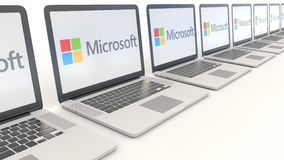 Modern laptops with Microsoft logo. Computer technology conceptual editorial 4K clip, seamless loop. Modern laptops with Microsoft logo. Computer technology stock footage