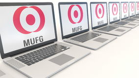 Modern laptops with MUFG logo. Computer technology conceptual editorial 3D rendering Stock Photo