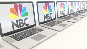 Modern laptops with National Broadcasting Company NBC logo. Computer technology conceptual editorial 3D rendering Royalty Free Stock Images