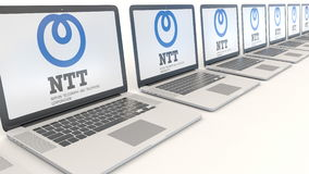 Modern laptops with Nippon Telegraph and Telephone Corporation NTT logo. Computer technology conceptual editorial 3D Stock Photos