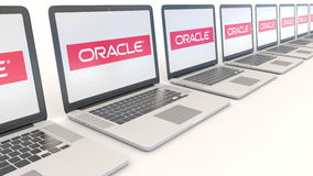 Modern laptops with Oracle Corporation logo. Computer technology conceptual editorial 4K clip, seamless loop. Modern laptops with Oracle Corporation logo stock video