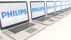Modern laptops with Philips logo. Computer technology conceptual editorial 3D rendering Royalty Free Stock Photography