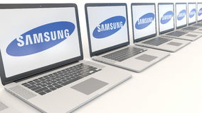 Modern laptops with Samsung logo. Computer technology conceptual editorial 3D rendering Stock Images