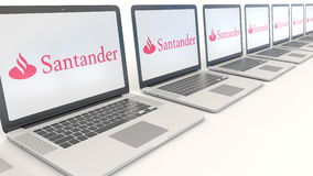 Modern laptops with Santander Serfin logo. Computer technology conceptual editorial 3D rendering Royalty Free Stock Photo