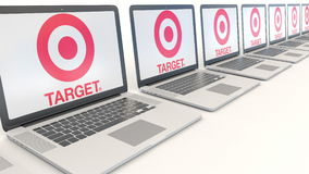 Modern laptops with Target Corporation logo. Computer technology conceptual editorial 3D rendering Stock Photo
