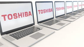 Modern laptops with Toshiba Corporation logo. Computer technology conceptual editorial 3D rendering Royalty Free Stock Photo