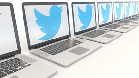 Modern laptops with Twitter, Inc. logo. Computer technology conceptual editorial 4K clip, seamless loop. Modern laptops with Twitter, Inc. logo. Computer stock video