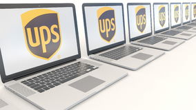Modern laptops with United Parcel Service UPS logo. Computer technology conceptual editorial 3D rendering Stock Photography