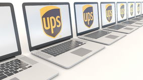 Modern laptops with United Parcel Service UPS logo. Computer technology conceptual editorial 4K clip, seamless loop. Modern laptops with United Parcel Service stock video footage