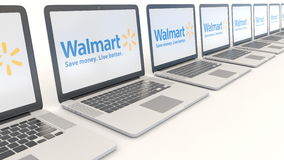 Modern laptops with Walmart logo. Computer technology conceptual editorial 4K clip, seamless loop. Modern laptops with Walmart logo. Computer technology stock footage