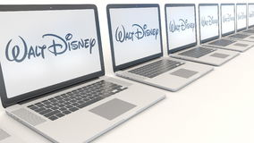 Modern laptops with Walt Disney Pictures logo. Computer technology conceptual editorial 3D rendering Royalty Free Stock Photo